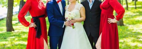 Couples, garçon d'honneur et demoiselle d'honneur de mariage Image libre de droits