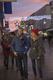 Couples Getting the Shopping for Christmas!. Mature couple are enjoying some winter shopping on an evening at christmas time Royalty Free Stock Photo