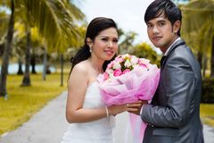 Couples of groom and bride holding bouquet flowers Stock Photo