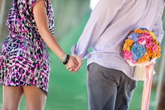 Couples hand in hand Stock Photo