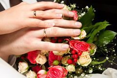 Couples hands. On the bouquet Royalty Free Stock Image