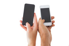 Couples hands holding smartphones Royalty Free Stock Photos