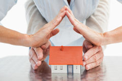 Couples hands with model house Stock Image