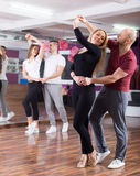 Couples having dancing class Royalty Free Stock Photo