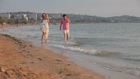 Couples Having Fun At The Beach stock video footage