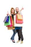 Couples heureux d'achats montrant des pouces  Photographie stock libre de droits