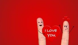 Couples heureux de doigt dans l'amour célébrant le Saint Valentin Image libre de droits