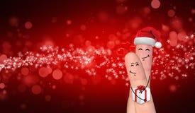 Couples heureux de doigt dans l'amour célébrant Noël Photo stock