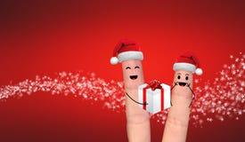 Couples heureux de doigt dans l'amour célébrant Noël Photos libres de droits