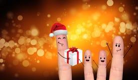 Couples heureux de doigt dans l'amour célébrant Noël Image libre de droits