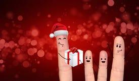 Couples heureux de doigt dans l'amour célébrant Noël Images stock