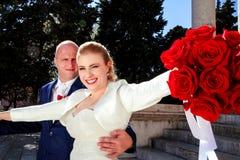 Couples heureux de jour du mariage Photographie stock libre de droits