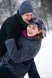 Couples heureux de l'hiver Photo stock