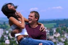 Couples heureux en soleil Photo libre de droits