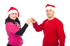 Couples heureux grillant avec le champagne Photographie stock