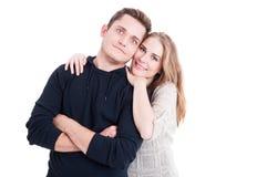 Couples heureux posant en tant qu'étant parfait et joyeux Images stock