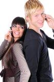 Couples heureux utilisant la technologie Images libres de droits