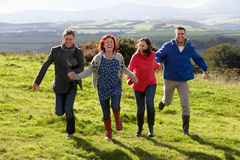 Couples holding hands on country walk Royalty Free Stock Photo