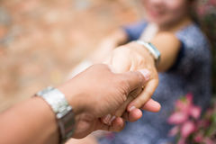 Couples holding hands Stock Photos