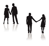 Couples holding hands silhouette Stock Photos