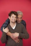 Couples homosexuels sur le fond rouge Photographie stock