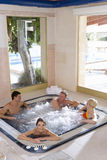 Couples in hot tub Stock Images