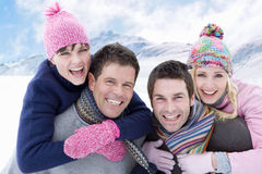 Couples hugging outdoors in the snow Royalty Free Stock Photos