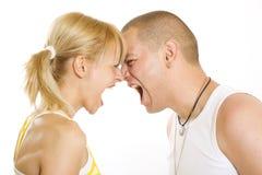 Couples hurlant à l'un l'autre Images stock