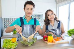Couples In Kitchen Royalty Free Stock Photography
