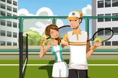 Couples jouant au tennis Photo stock
