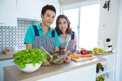 Couples in kitchen Royalty Free Stock Image