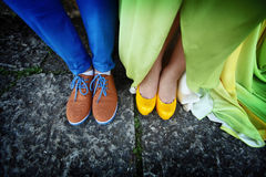 Couples legs dressed in bright colorful shoes Stock Photography