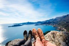 Couples legs on the mountain Stock Photo
