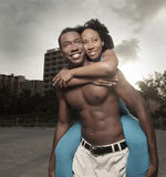 Couples lifestyle. Attractive young couple having fun at the beach Royalty Free Stock Photos
