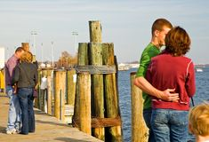 Couples in love on dock royalty free stock photos