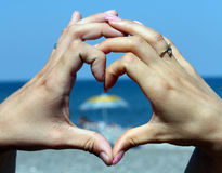 Couple in love showing heart Royalty Free Stock Images