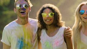 Couples in love having good time, enjoying the Festival of colors in slow motion. Stock footage stock video