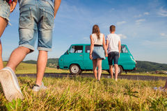 Couples in love, nature, blue sky, campervan, back view Royalty Free Stock Photography