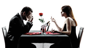 Couples lovers dating dinner  dispute silhouettes Royalty Free Stock Photos