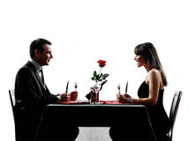 Couples lovers dating dinner hungry silhouettes Royalty Free Stock Images
