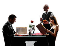 Couples lovers dating dinner silhouettes Stock Photo