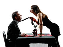 Couples lovers dating dinner silhouettes Stock Photos