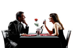 Couples lovers dating dinner silhouettes Royalty Free Stock Photos