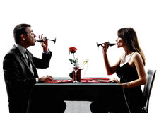 Couples lovers drinking wine dinner silhouettes Stock Photo
