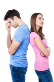 Couples malheureux se tenant de nouveau au dos Photographie stock libre de droits