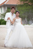 Couples of man and woman in wedding suit Stock Images