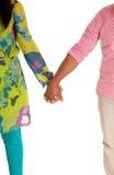 Couples marchant de pair Photographie stock libre de droits