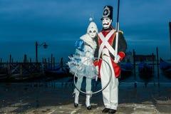 Couples masqués à l'aube Photo libre de droits