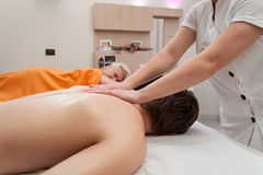 Couples massage in the back stock photo