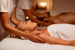 Couples Massage At Spa, Girlfriend And Boyfriend Enjoying Relaxing Treatment